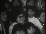 Ko Lo-Chuen, Lydia Shum, and Lai Man sit amidst real-life Connie Chan fans in <i>Movie-Fan Princess</i>.
