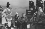 On the set of THE 14 AMAZONS (from left to right):