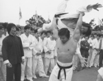 Behind the scenes of ENTER THE DRAGON: rehearsal for Bolo Yeung's scene in which he is punishing the negligent bodyguards with Lam Cheng Ying being thrown.