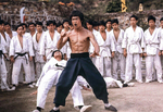 One against the multitude: Bruce Lee downing Yuen Bun with a backfist in ENTER THE DRAGON