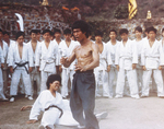 Yuen Bun going down to the ground by Bruce Lee's backfist in ENTER THE DRAGON