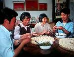 A teenage Jet Li enjoying a dinner with his family.