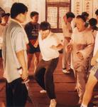 Behind the scenes photo, Tsui Hark coaches a stuntman